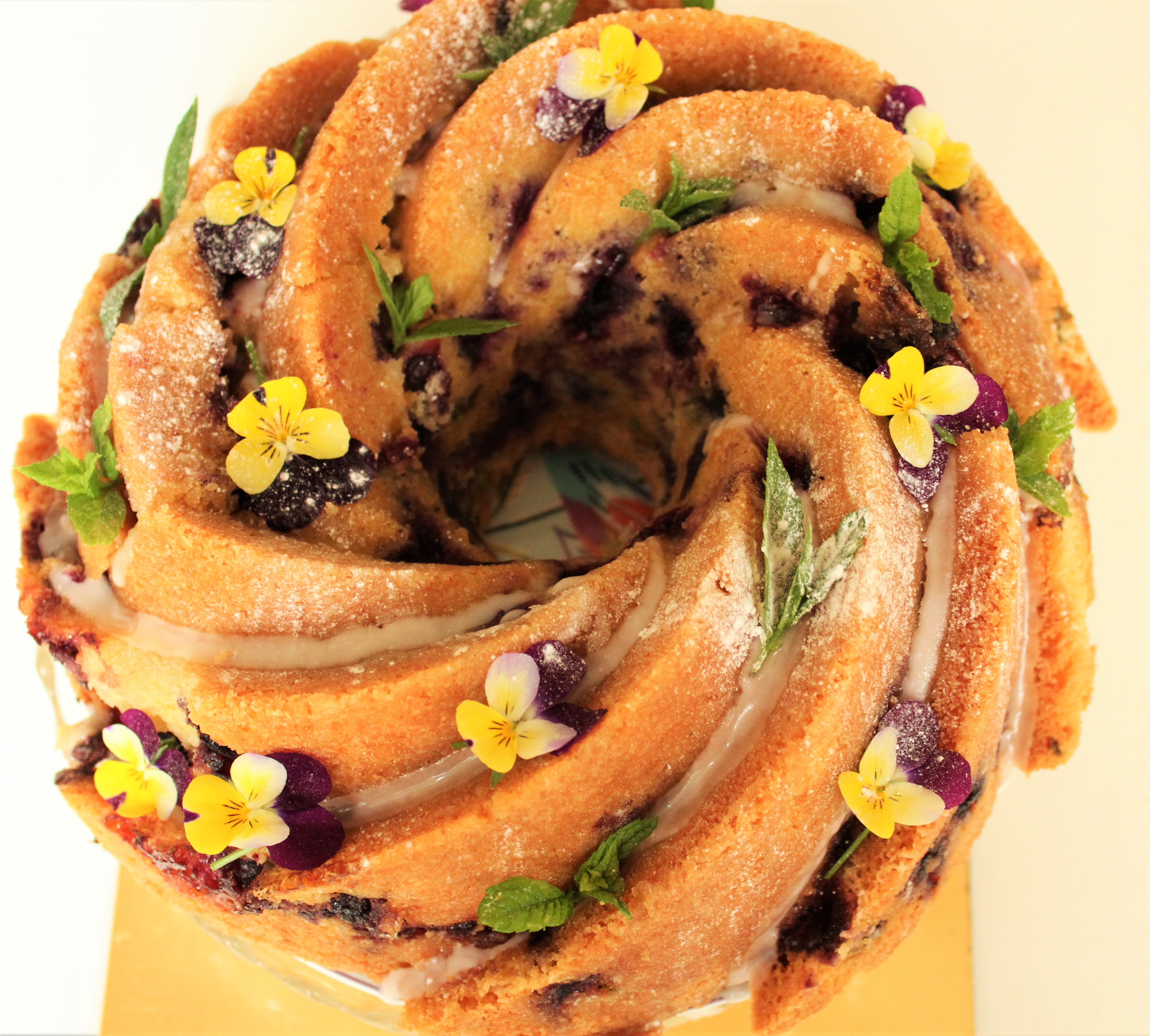 Lemon, Blueberry, Mint Drizzle cake with edible flowers.JPG
