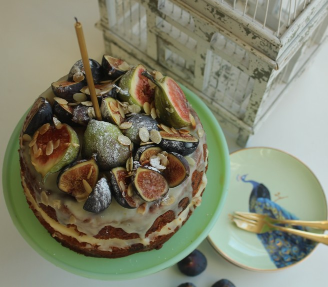 Fig birthday cake with candle